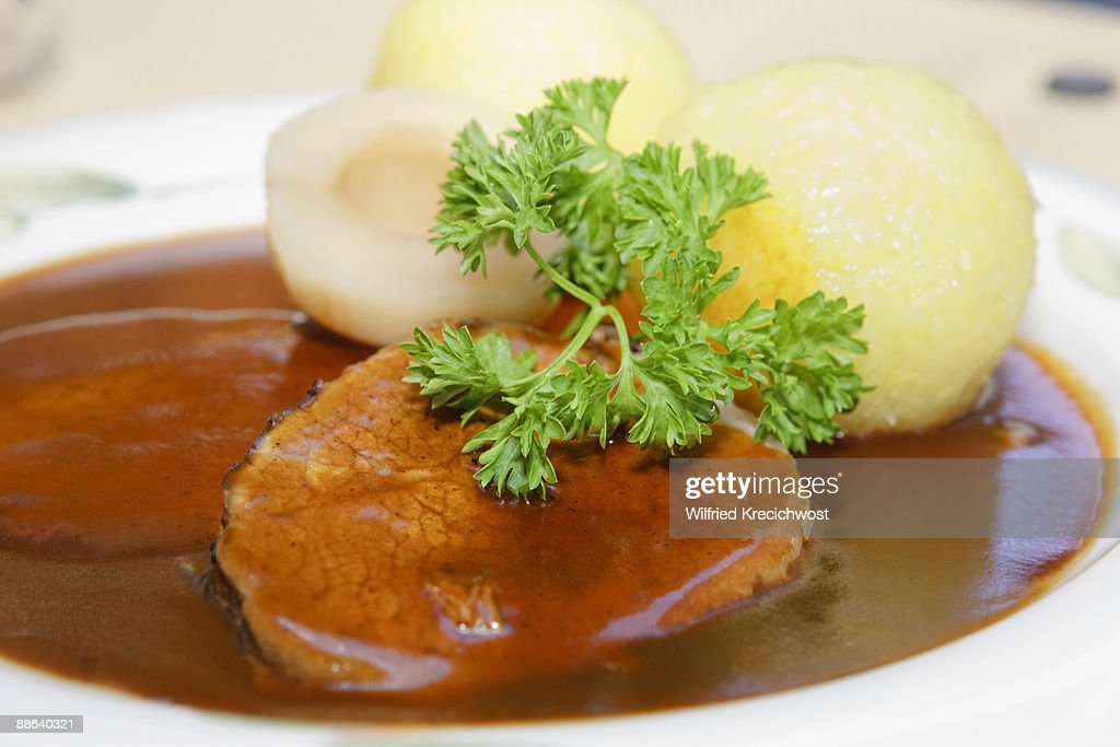 Sauerbraten, marinated beef with dumblings : Stock Photo