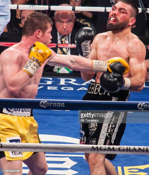 Saul Alvarez leands a left against Alfredo Angulo and wins by 10th round TKO in their Junior Middleweight unification boxing match at the MGM Grand...