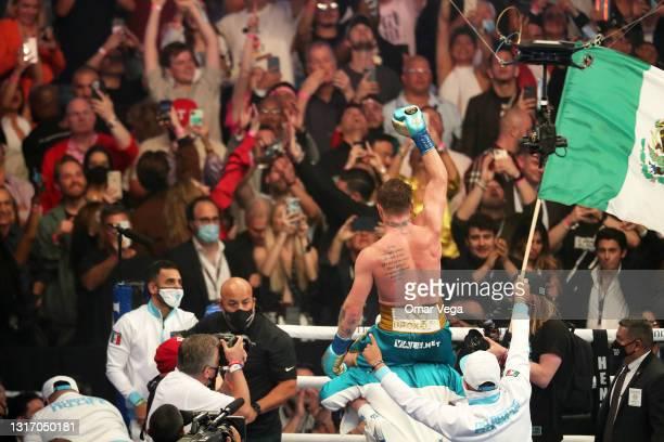 Saul Canelo Alvarez celebrates his win against Billy Joe Saunders during WBC, WBA Super, WBO and Ring Magazine World Super-Middleweight...