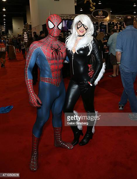 Saul Cervantes of California dressed as SpiderMan and Jare Longacre of California dressed as Black Cat from ' The Amazing SpiderMan' movie attend...