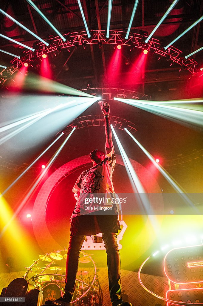 Saul 'Chase' Milton, MC Rage and Will 'Status' Kennard of Chase & Status perform on stage during the opening night of the Brand New Machine November 2013 UK Arena Tour at Nottingham Capital FM Arena on October 31, 2013 in Nottingham, England.