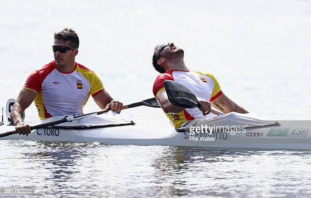 Saul Craviotto and Cristian Toro of Spain celebrate after winning gold in the Men's Kayak Double 200m Final at the Lagoa Stadium on Day 13 of the...