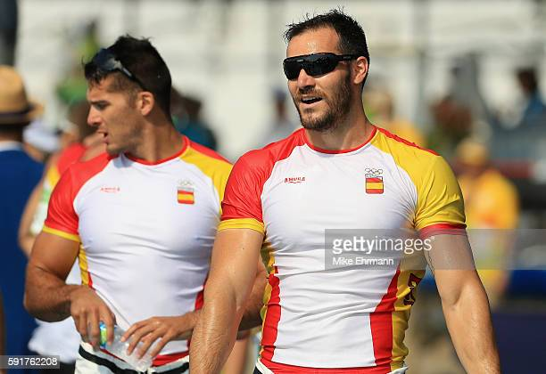 Saul Craviotto and Cristian Toro of Spain celebrate after winning gold in the Men's Kayak Double 200m event at the Lagoa Stadium on Day 13 of the...