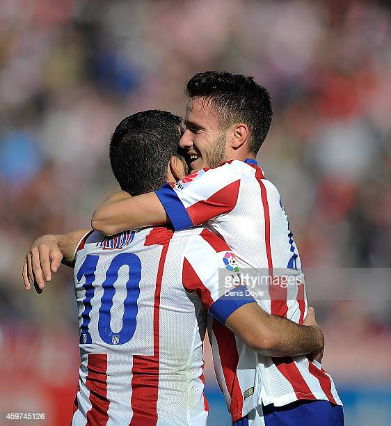 Saul Diges of Club Atletico de Madrid celebrates with Arda Thuran after scoring his team's opening goal during the La Liga match between Club...