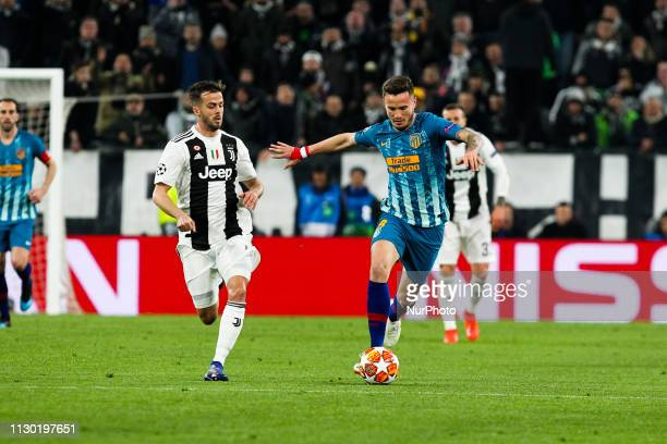 Saul Niguez and Miralem Pjanic during the UEFA Champions League round of 16 second leg match between Club Atletico de Madrid and Juventus FC at...