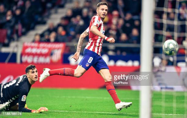 Saul Niguez and Sergio Herrera during La Liga match between Club Atletico de Madrid and CA Osasuna at Wanda Metropolitano on December 14, 2019 in...