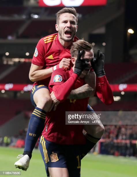 Saul Niguez celebrates his sides first goal with goalscorer Fabian Ruiz of Spain during the UEFA Euro 2020 Qualifier between Spain and Romania on...