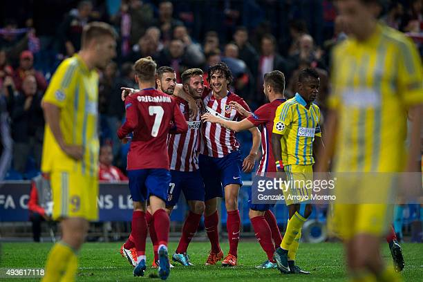 Saul Niguez celebrates scoring their opening goal with teammates Gabi Fernandez and Stefan Savic during the UEFA Champions League Group C match...