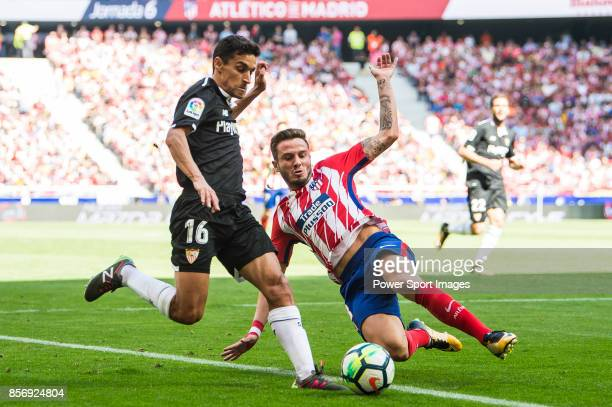 Saul Niguez Esclapez of Atletico de Madrid battles for the ball with Jesus Navas Gonzalez of Sevilla FC during the La Liga 201718 match between...