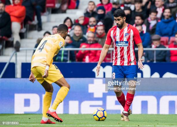 Saul Niguez Esclapez of Atletico de Madrid competes for the ball with Jonas Ramalho Chimney of Girona FC during the La Liga 201718 match between...