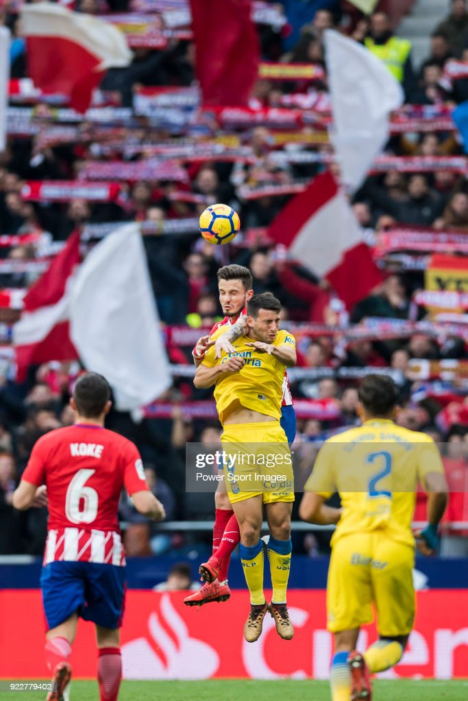 Saul Niguez Esclapez (L) of Atletico de Madrid competes for the ball with Jonathan Calleri of UD Las Palmas during the La Liga 2017-18 match between Atletico de Madrid and UD Las Palmas at Wanda Metropolitano on January 28 2018 in Madrid, Spain.