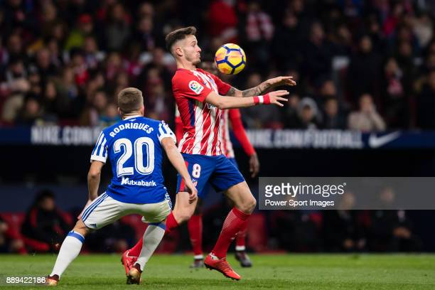 Saul Niguez Esclapez of Atletico de Madrid fights for the ball with Kevin Rodrigues of Real Sociedad during the La Liga 201718 match between Atletico...