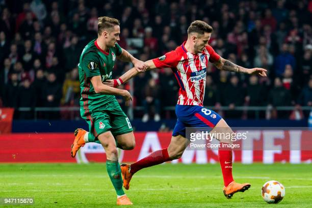 Saul Niguez Esclapez of Atletico de Madrid fights for the ball with Anton Miranchuk of FC Lokomotiv Moscow during the UEFA Europa League 201718 Round...