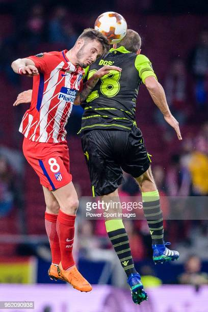Saul Niguez Esclapez of Atletico de Madrid fights for the ball with Bas Dost of Sporting CP during the UEFA Europa League quarter final leg one match...