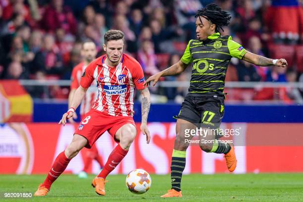 Saul Niguez Esclapez of Atletico de Madrid fights for the ball with Gelson Martins of Sporting CP during the UEFA Europa League quarter final leg one...