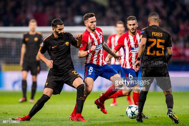 Saul Niguez Esclapez of Atletico de Madrid flights the ball with Bruno Peres of AS Roma during the UEFA Champions League 201718 match between...