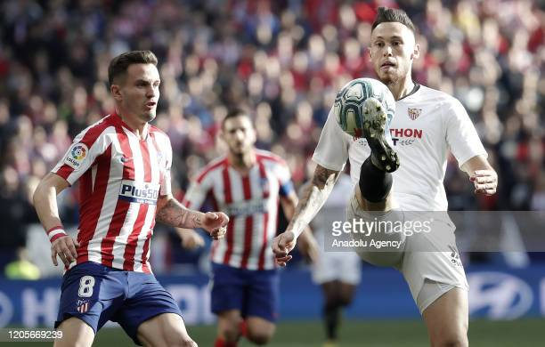 Saul Niguez of Atletico de Madrid and Lucas Ocampos of Sevilla FC battle for the ball during the La Liga match between Club Atletico de Madrid and...