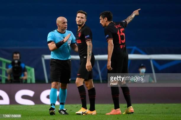 Saul Niguez of Atletico de Madrid and Stefan Savic of Atletico de Madrid confront referee Szymon Marciniak during the UEFA Champions League Quarter...