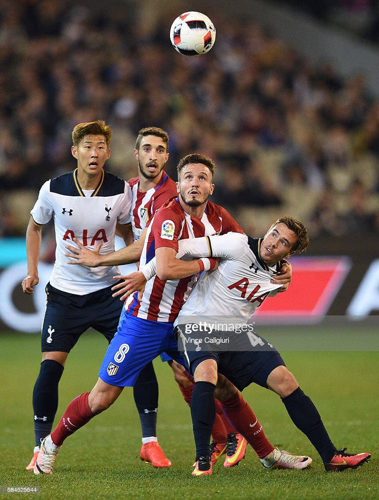 Saul Niguez of Atletico de Madrid and Will Miller of Tottenham Hotspur contest for the ball during 2016 International Champions Cup Australia match between Tottenham Hotspur and Atletico de Madrid at Melbourne Cricket Ground on July 29, 2016 in Melbourne, Australia.