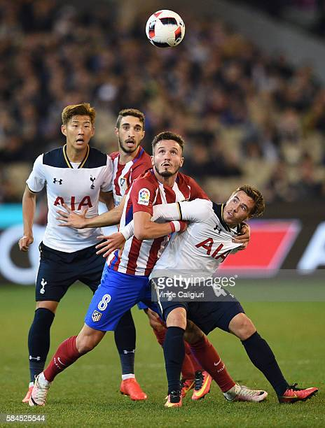 Saul Niguez of Atletico de Madrid and Will Miller of Tottenham Hotspur contest for the ball during 2016 International Champions Cup Australia match...