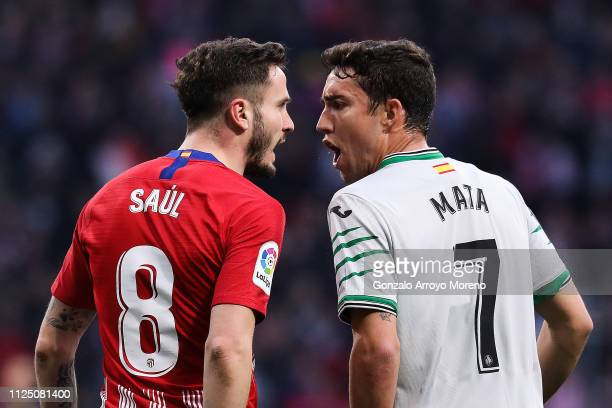 Saul Niguez of Atletico de Madrid argues with Jaime Mata of Getafe CF during the La Liga match between Club Atletico de Madrid and Getafe CF at Wanda...