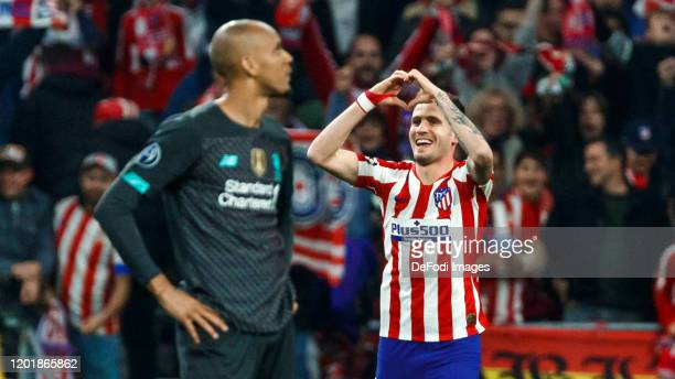 Saul niguez of Atletico de Madrid celebrates after scoring his team`s first goal 10 Fabinho of Liverpool FC looks dejected during the UEFA Champions...
