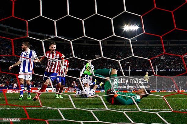 Saul Niguez of Atletico de Madrid celebrates scoring their second goal behind goalkeeper Geronimo Rulli of Real Sociedad de Futbol during the La Liga...