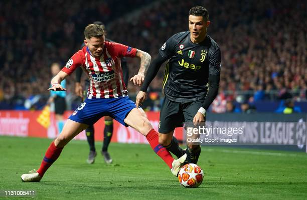 Saul Niguez of Atletico de Madrid competes for the ball with Cristiano Ronaldo of Juventus during the UEFA Champions League Round of 16 First Leg...