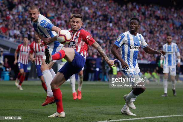 Saul Niguez of Atletico de Madrid competes for the ball with Vasyl Kravets and his teammate Kenneth Omeruo of Deportivo Leganese during the La Liga...