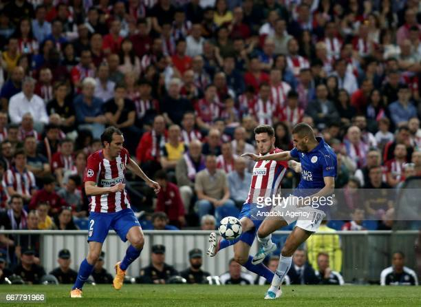 Saul Niguez of Atletico de Madrid is in action against Islam Slimani of Leicester City during the Champions League quarter final first leg match...