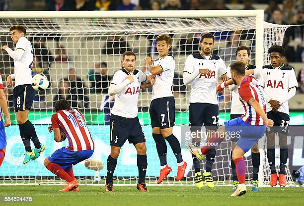 Saul Niguez of Atletico de Madrid takes a free kick as Tottenham Hotspur players defend during 2016 International Champions Cup Australia match...