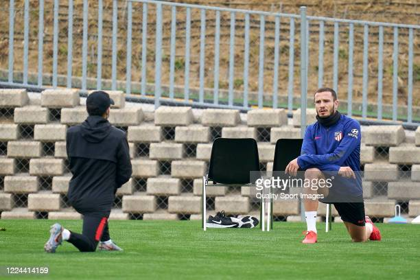Saul Niguez of Atletico de Madrid with a coach during a training session at Estadio Cerro del Espino on May 12 2020 in Madrid Spain