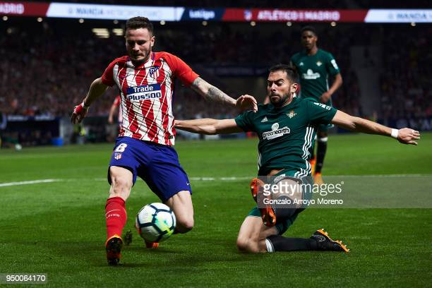 Saul Niguez of Atletico de Madrid zcompetes for the ball with Jordi Amat of Real Betis Balompie during the La Liga match between Club Atletico Madrid...