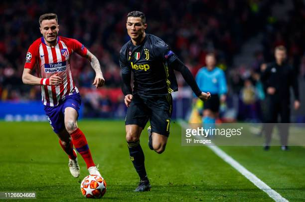 Saul Niguez of Atletico Madrid and Cristiano Ronaldo of Juventus battle for the ball during the UEFA Champions League Round of 16 First Leg match...