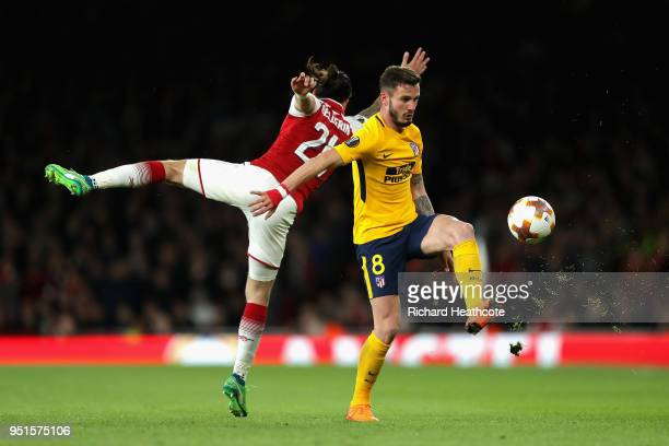 Saul Niguez of Atletico Madrid and Hector Bellerin of Arsenal in action during the UEFA Europa League Semi Final leg one match between Arsenal FC and...