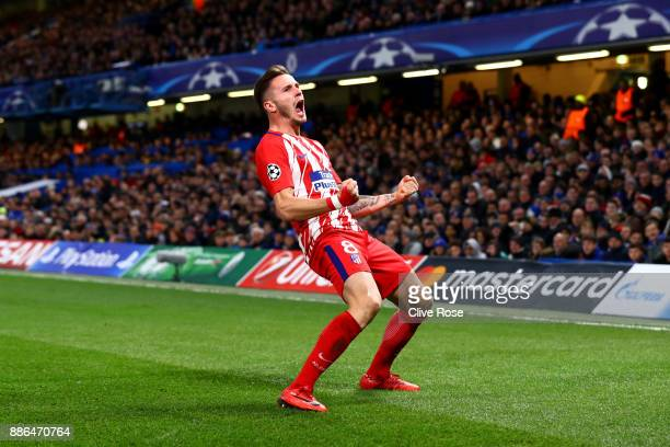 Saul Niguez of Atletico Madrid celebrates after scoring his sides first goal during the UEFA Champions League group C match between Chelsea FC and...