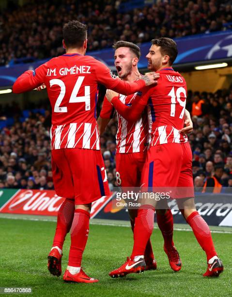 Saul Niguez of Atletico Madrid celebrates after scoring his sides first goal with Jose Maria Gimenez of Atletico Madrid and Lucas Hernandez of...