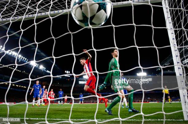 Saul Niguez of Atletico Madrid celebrates after scoring his sides first goal as Thibaut Courtois of Chelsea reacts during the UEFA Champions League...