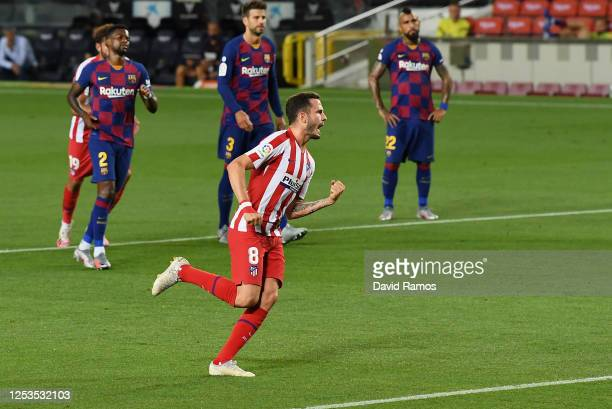 Saul Niguez of Atletico Madrid celebrates after scoring his team's first goal by penalty during the Liga match between FC Barcelona and Club Atletico...