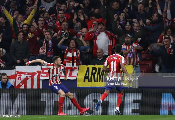 Saul Niguez of Atletico Madrid celebrates with his team mates after scoring his team's first goal during the UEFA Champions League round of 16 first...