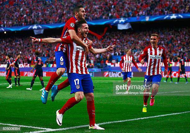 Saul Niguez of Atletico Madrid celebrates with Koke of Atletico Madrid and team mates as he scores their first goal during the UEFA Champions League...