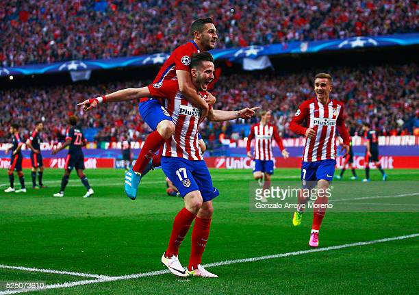 Saul Niguez of Atletico Madrid celebrates with team mates Antoine Griezmann and Koke as he scores their first goal during the UEFA Champions League...