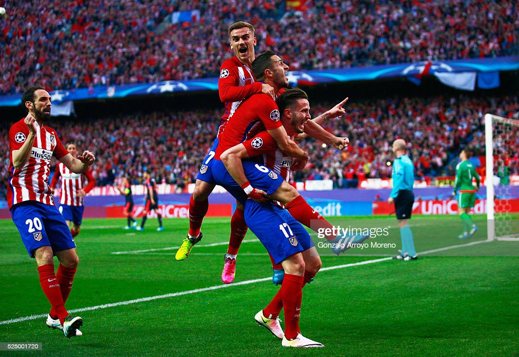 Saul Niguez of Atletico Madrid (17) celebrates with team mates as he scores their first goal during the UEFA Champions League semi final first leg match between Club Atletico de Madrid and FC Bayern Muenchen at Vincente Calderon on April 27, 2016 in Madrid, Spain.