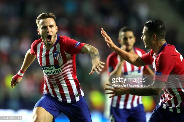 Saul Niguez of Atletico Madrid celebrates with teammates after scoring his sides third goal during the UEFA Super Cup between Real Madrid and...