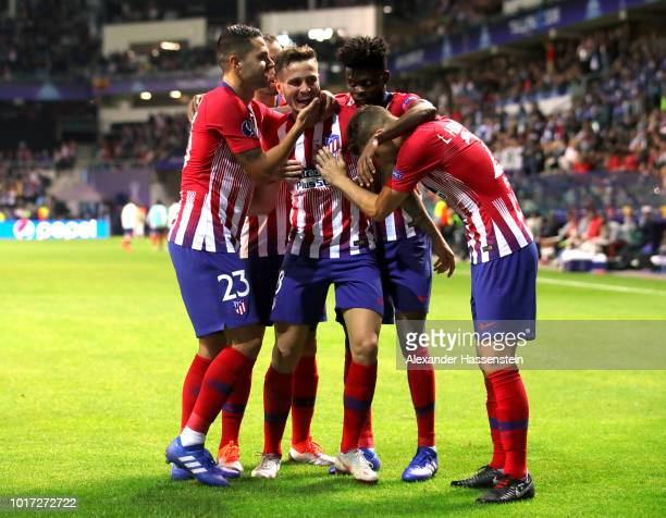 Saul Niguez of Atletico Madrid celebrates with teammates after scoring his team's third goal during the UEFA Super Cup between Real Madrid and...