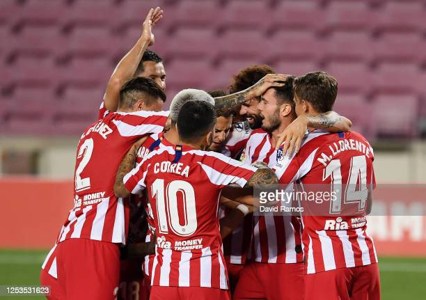 Saul Niguez of Atletico Madrid celebrates with teammates after scoring his team's first goal by penalty during the Liga match between FC Barcelona...