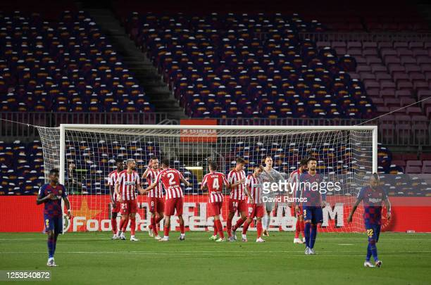 Saul Niguez of Atletico Madrid celebrates with teammates after scoring his team's second goal by penalty during the Liga match between FC Barcelona...