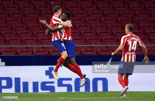 Saul Niguez of Atletico Madrid celebrates with Thomas Partey after scoring his team's first goal during the La Liga match between Club Atletico de...