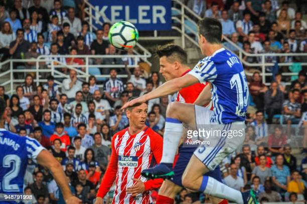 Saul Niguez of Atletico Madrid duels for the ball with Aritz Elustondo of Real Sociedad during the Spanish league football match between Real...