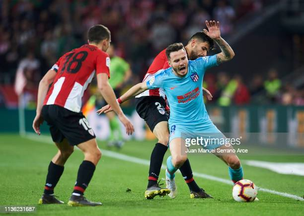 Saul Niguez of Atletico Madrid duels for the ball with Kenan Kodro of Athletic Club during the La Liga match between Athletic Club and Club Atletico...